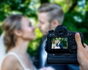 bride-groom-camera-photo-wedding-photographer-nj-ny-300x240